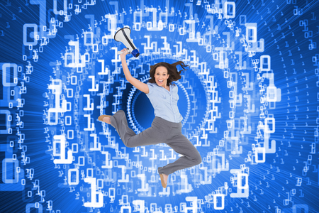 Composite image of cheerful classy businesswoman on white background jumping while holding megaphone photo