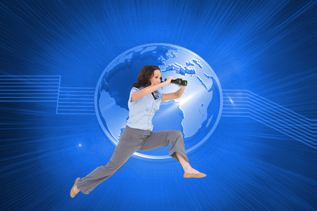 Composite image of cheerful classy businesswoman on white background jumping while holding binoculars photo