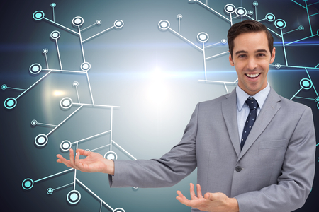 Composite image of young businessman presenting something photo