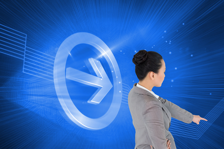 woman looking down: Composite image of asian businesswoman pointing