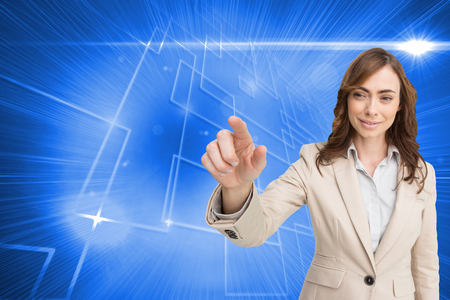 Composite image of portrait of businesswoman touching invisible screen on white background photo