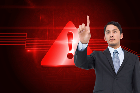 light brown hair: Composite image of serious asian businessman pointing