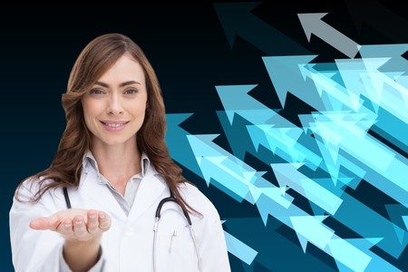 Composite image of smiling brunette doctor presenting her hand photo