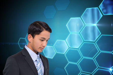 Composite image of serious asian businessman  photo