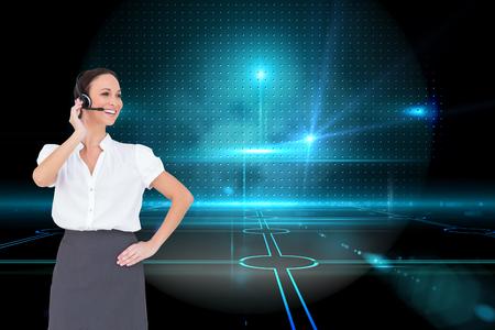 call center agent: Immagine composita di intelligente lavoro agente di call center allegro mentre posa su sfondo bianco