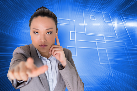 Composite image of thoughtful asian businesswoman pointing photo