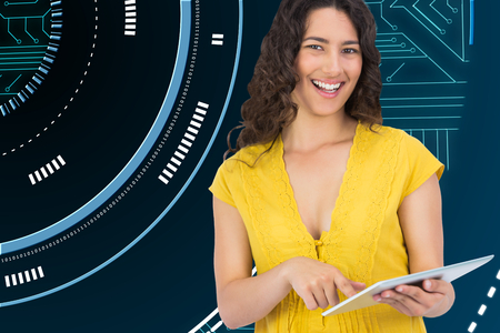 scrolling: Composite image of smiling casual young woman scrolling on her tablet computer