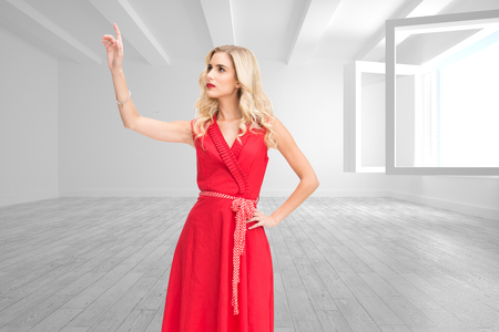 Composite image of elegant blonde standing pointing in red dress photo
