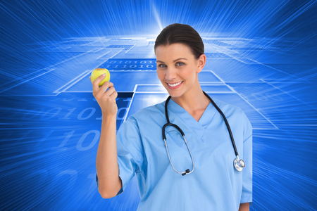 Composite image of happy surgeon holding an apple and smiling at camera on white background photo