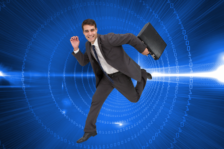 Composite image of cheerful attractive businessman in a hury photo