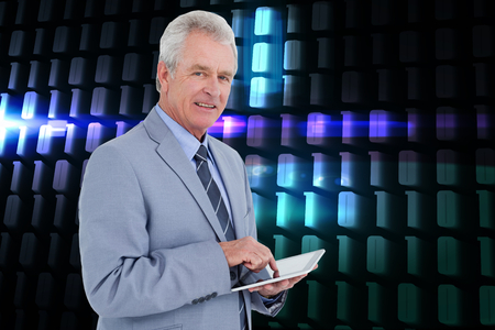 Composite image of side view of mature tradesman with tablet computer against a white background photo