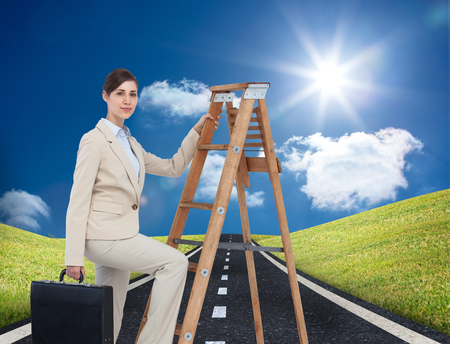 Composite image of businesswoman climbing career ladder with briefcase and looking at camera photo