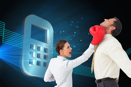 Composite image of businesswoman hitting a businessman with boxing gloves on white background Stock Photo