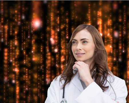 Composite image of thoughtful brunette doctor looking away photo