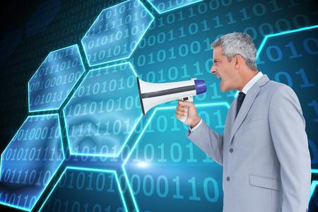 businessman using a megaphone: Composite image of businessman shouting in loudspeaker