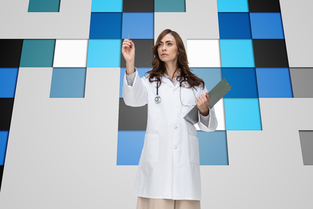 Composite image of stern brunette doctor pointing photo