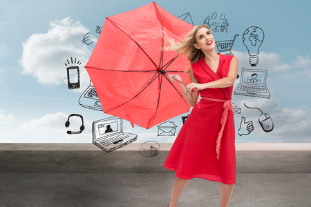 Composite image of elegant happy blonde holding umbrella photo
