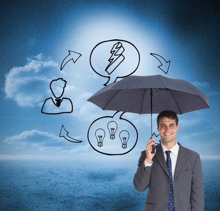 Composite image of happy businessman holding grey umbrella on white background photo
