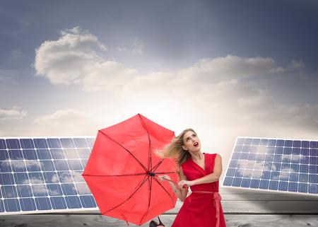 Composite image of elegant happy blonde holding umbrella photo