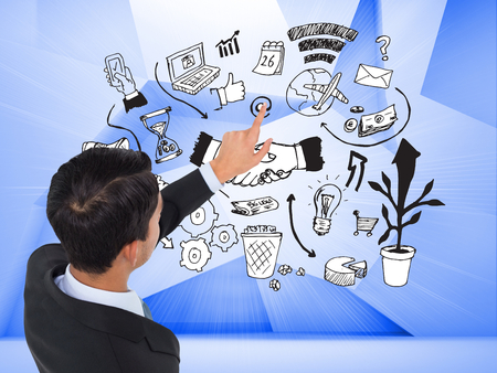 Composite image of asian businessman pointing photo
