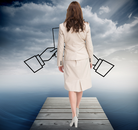 Composite image of classy businesswoman walking away from camera against white background photo