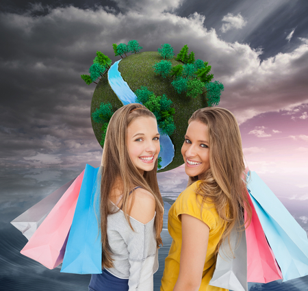 Composite image of two young women with shopping bags against white background Stock Photo - 26892622