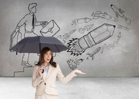 Composite image of elegant businesswoman holding black umbrella against white background photo