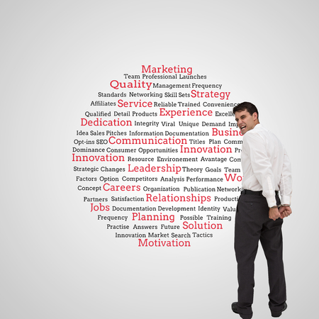 Composite image of rear view of young businessman wearing handcuffs on white background photo