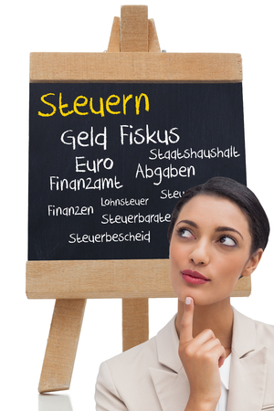 finanzen: Composite image of smiling businesswoman thinking on white background