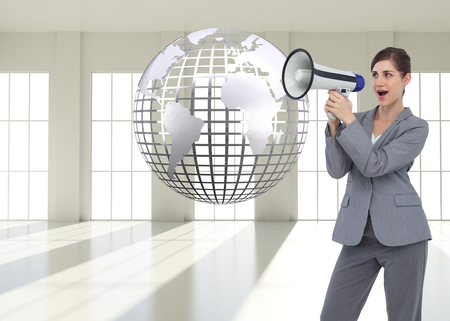Composite image of businesswoman with loudspeaker Stock Photo - 26893282