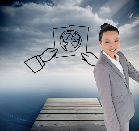 composite image: Composite image of smiling asian businesswoman pointing Stock Photo