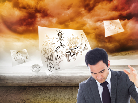 unsmiling: Composite image of unsmiling businessman catching