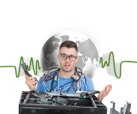Composite image of confused young it professional with cables and phone in front of open cpu over white background photo