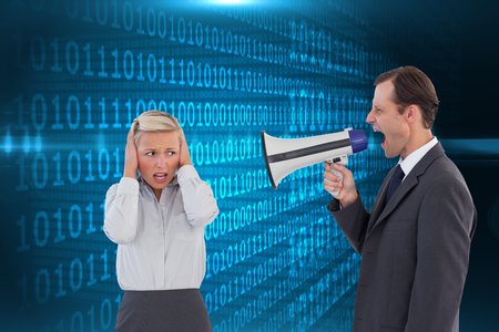 Composite image of businessman shouting at colleague with his bullhorn on white background photo