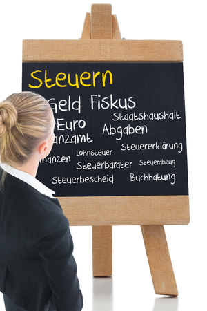 finanzen: Composite image of blonde businesswoman standing with hands on hips