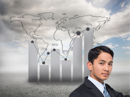 Composite image of stern asian businessman pointing photo