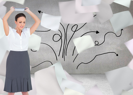 Composite image of angry businesswoman throwing her tablet pc while posing on white background photo