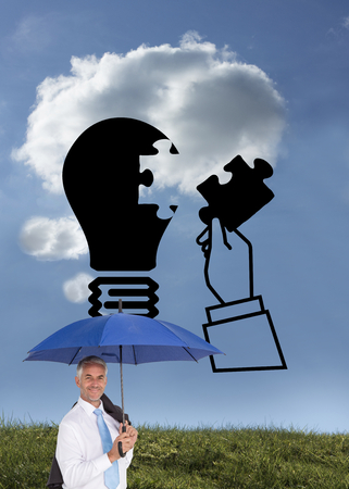 Composite image of businessman holding umbrella smiling at camera on white background photo