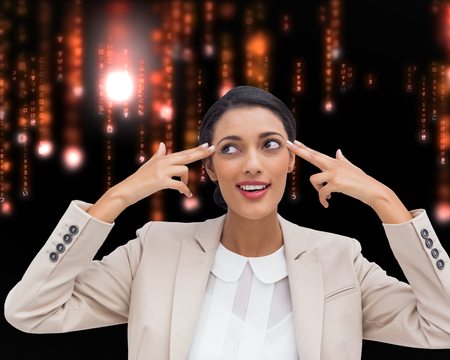 Composite image of confident young businesswoman pointing her head with her fingers photo