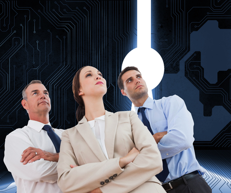 Composite image of serious work team posing together looking away on white background photo