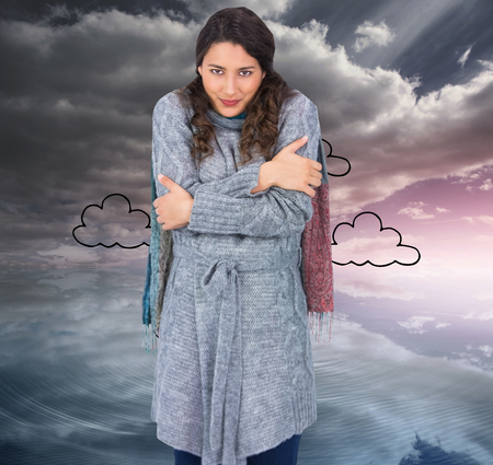 Composite image of peaceful pretty model with winter clothes being cold photo
