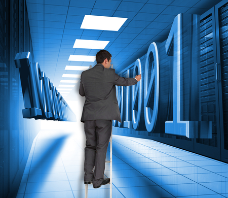 Composite image of businessman standing on ladder writing photo