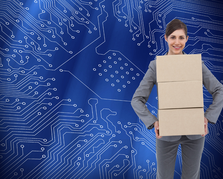 proportionate: Composite image of smiling businesswoman carrying cardboard boxes