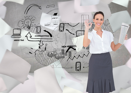 Composite image of stylish businesswoman making gesture while holding newspaper photo