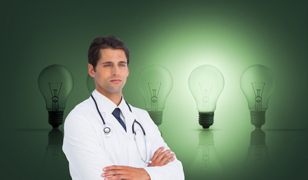 Composite image of serious doctor with arms crossed on white background photo