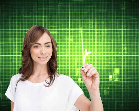 Composite image of smiling businesswoman holding marker against white background photo