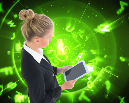 composite image: Composite image of blonde businesswoman holding new tablet Stock Photo