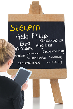 finanzen: Composite image of blonde businesswoman holding new tablet Stock Photo