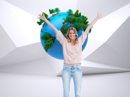 Composite image of a full length shot of a smiling woman who has her arms raised up against a white background
