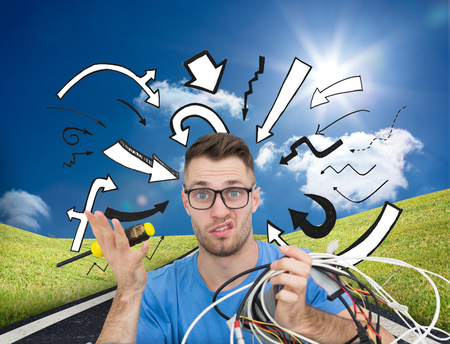Composite image of portrait of confused young it professional with screw driver and cables in front of open cpu over white background Stock Photo